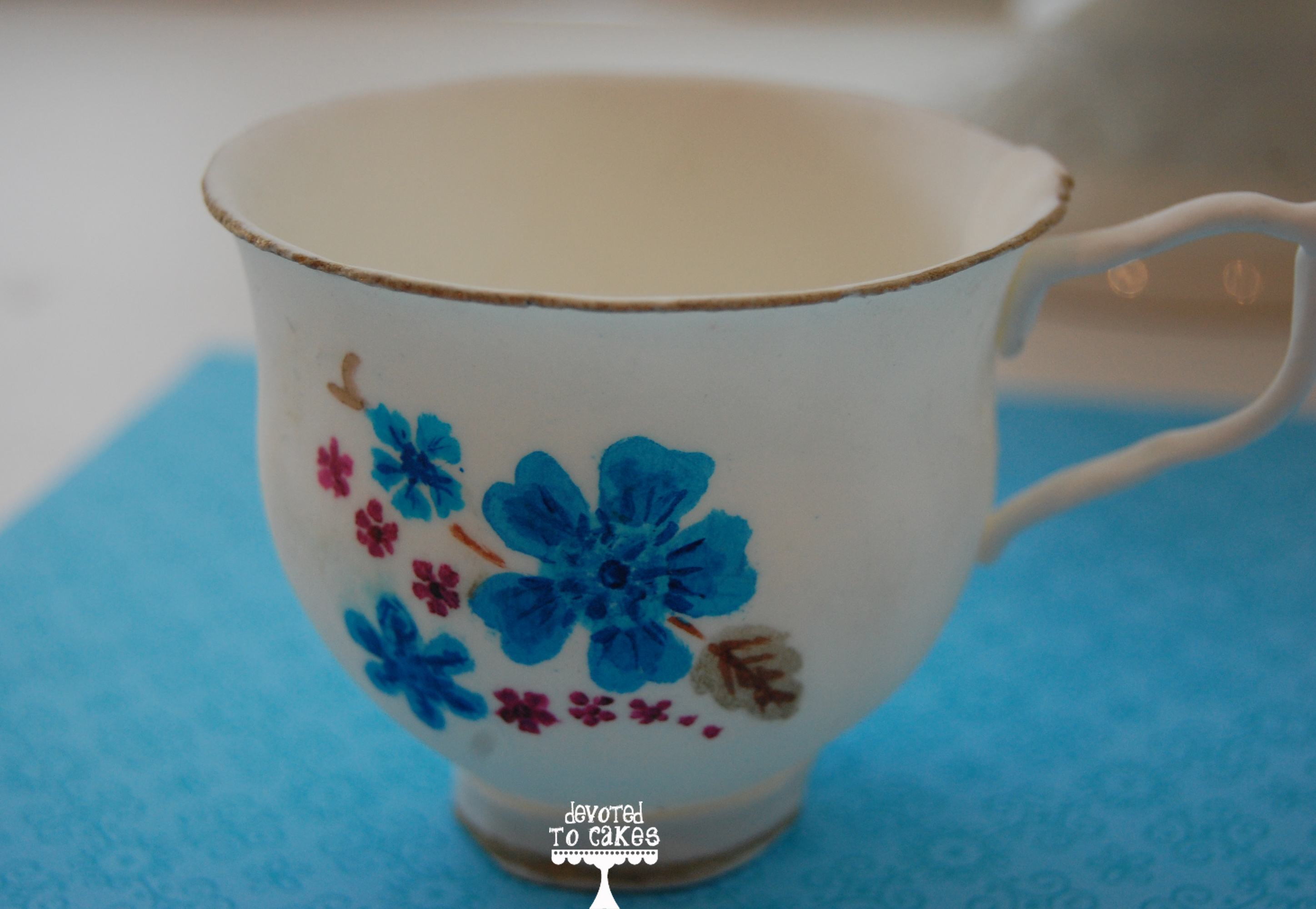 Vintage blue lace cake with handpainted sugar teacup